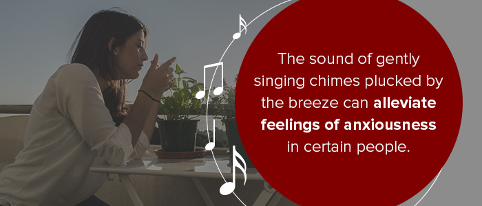 The sound of gently singing chimes plucked by the breeze can alleviate feelings of anxiousness in certain people.