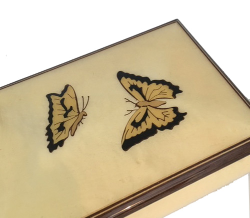 Close up view of the two butterflies on the music box.