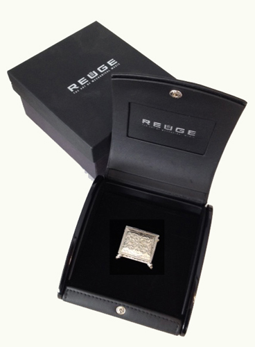Reuge Stellina (world's smallest sterling silver music box)