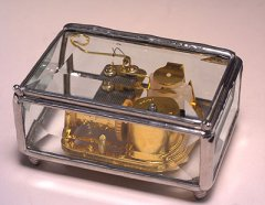 beveled glass music box with 18 note movement