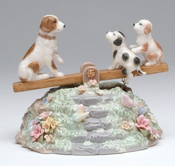 Puppies on a see saw Musical animated figurine