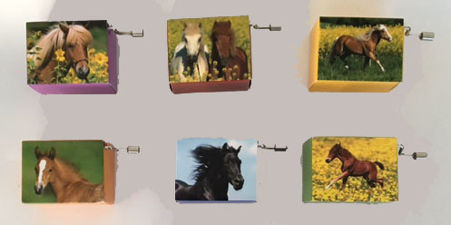 hand crank hurdy gurdy music boxes with images of horses.