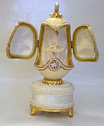 White Goose egg music box with double doors revealing Ballerina