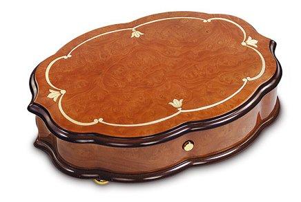 Reuge Fleur De Lys Design on Scalloped Oval Cabinet