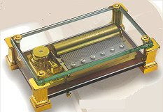 Reuge Music Box Crystal 72 note with column feet.