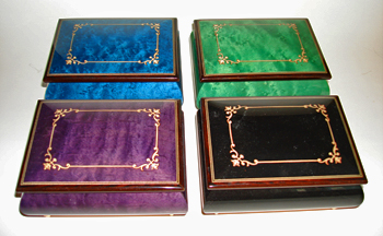 Arabesque Inlaid musical boxes in four available colors.