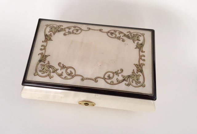 White finished musical box with silver grey baroque border