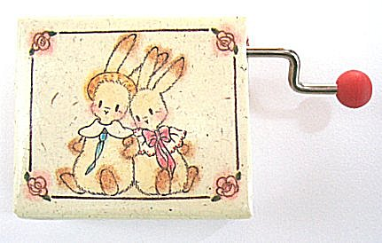 Two Little Bunnies pictured on hand crank music box