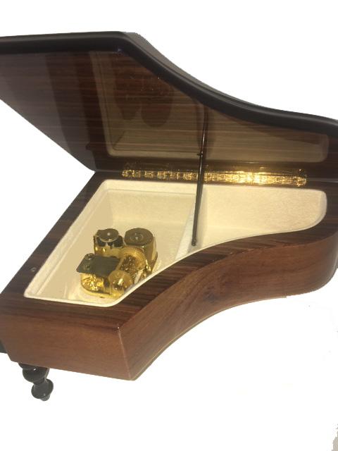 Interior view of burl elm italian 18 note piano