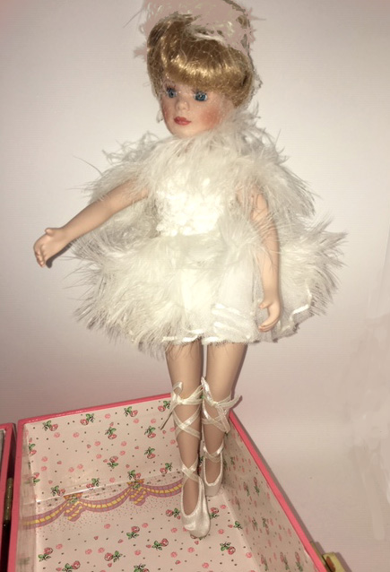 Cadence, a ballerina in Feathered costume