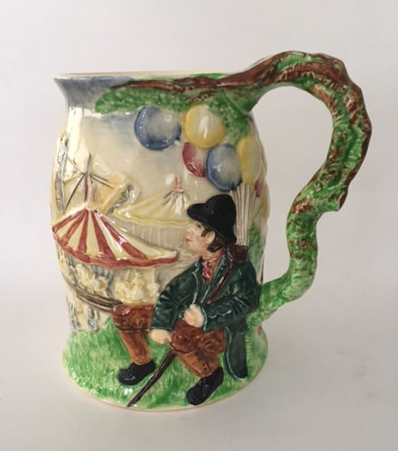 Carousel view on majolica stein