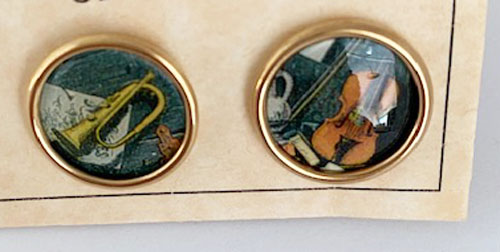 Close up of musical postage stamp cufflinks