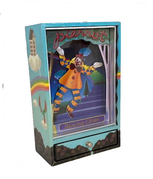 Dancing clown dressed in orange and blue. Shadow box with drawer