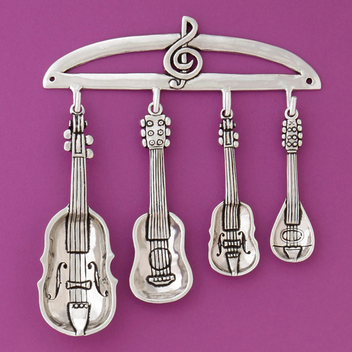 est of four stringed instrument spoons and rack