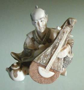 Tiny Mammoth Tusk Ivory Male Musician