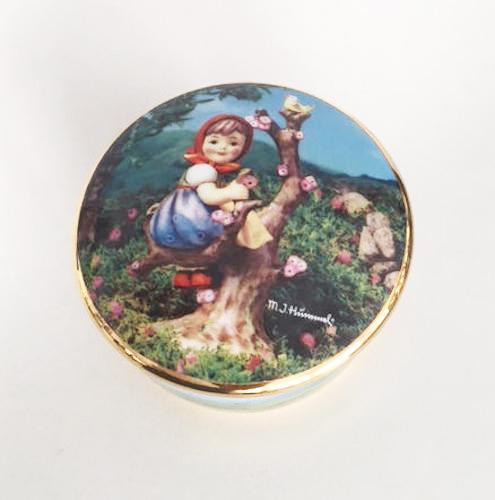 porcelain keepsake music box features Hummel's Apple Tree Girl
