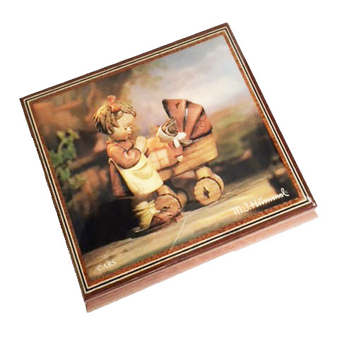 Hummel's Doll Mother decoupage image on lid of Ercolano music box