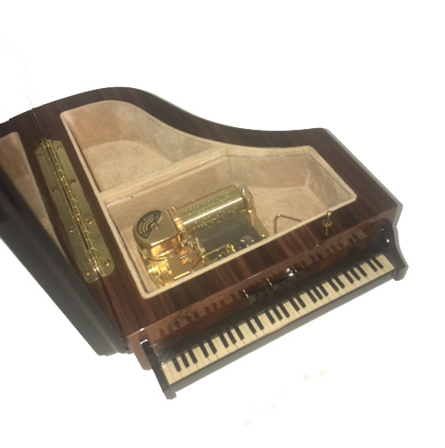 Interior view of 30 note mechanism and jewelry compartment of Burl Walnut Piano Music Box