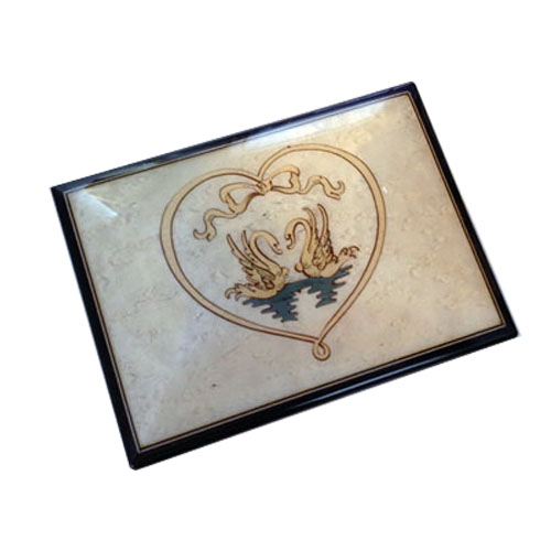 White music box featuring two swans framed with heart shaped riggon