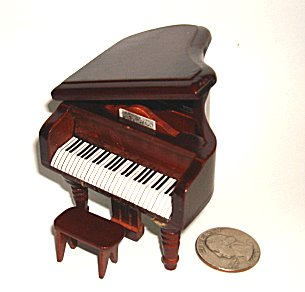 Small miniature baby grand piano in  Brown