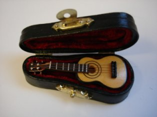 "2.5"" Tenor Guitar and case"