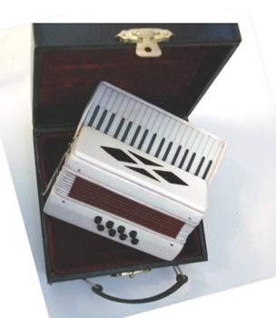 White miniature accordian