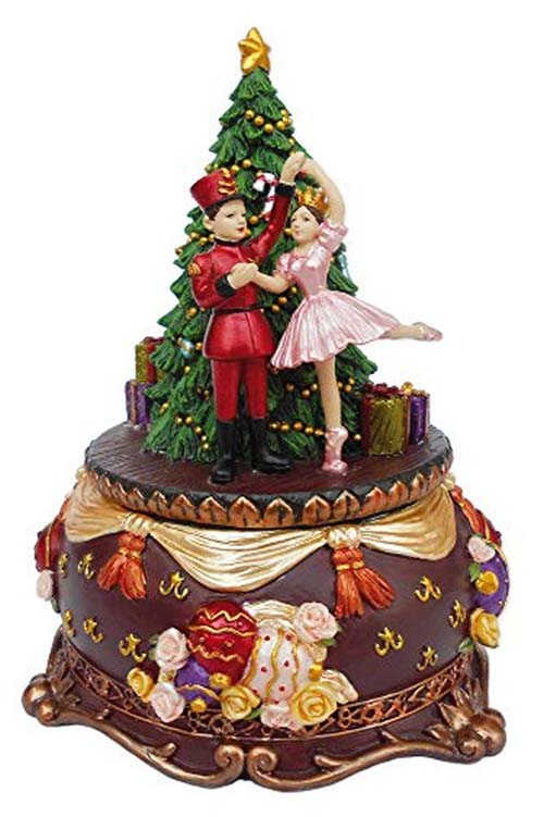 Clara and her Nutcracker Prince Dance in front of Christmas Tree