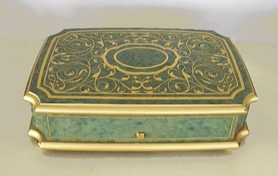 brass inlay on light green music box