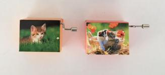 pair of kitten manivelles (hand crank music boxes)