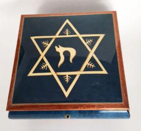 white star of David with Chai on blue Music Box
