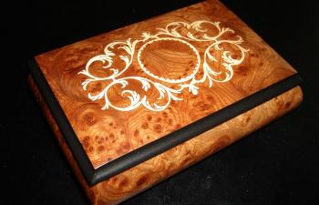 elm music box with scroll work