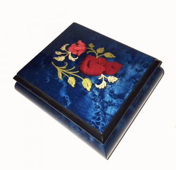 lovely red rose on deep blue music box