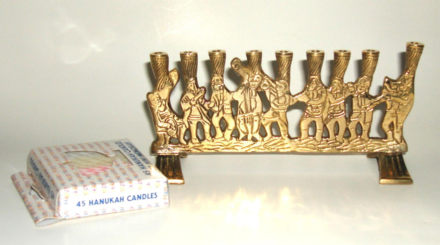 small brass Chanukah menorah with musicians