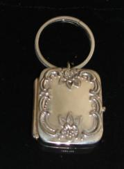 Sterling key ring with baroque music box