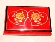 Entwined Hearts on Bright Red Music Box