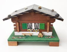 Swiss Chalet music box with bench and logs