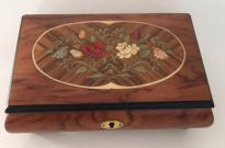 two flowers leaves and buds framed in birch on Rosewood Musical Box