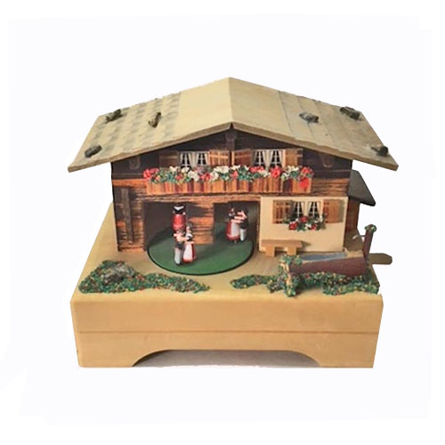 Thre couples dance in and out of Swiss Chalet Music Box