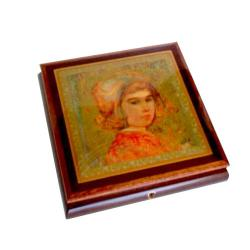 "A Decoupage by Edna Hibel ""Sophia"" graces the lid of this Mahogany Music Box"
