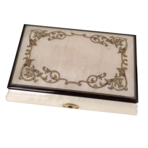 White finished musical box with silvery gold baroque border