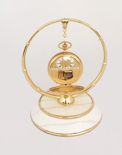 White enamel and brass pocket watch display stand by Boegli Watch Co.