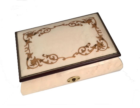 White finished musical box with gold baroque border